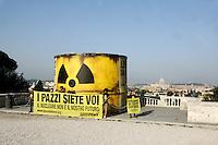 """Attivisti di Greenpeace incatenati davanti ad un bidone contenente altri attivisti, durante un'azione antinucleare sulla terrazza del Pincio, Roma, 25 maggio 2011..Greenpeace activists in chains hold a banner reading """"You are crazy. Nuclear is not our future"""", past a tank containing others activists, during an antinuclear protest at Pincio's terrace, Rome, 25 may 2011. A referendum on nuclear power in Italy is scheduled for 12 and 13 june..UPDATE IMAGES PRESS/Riccardo De Luca"""