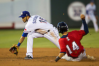 Round Rock Express shortstop Luis Sardinas (15) waits for a throw as Oklahoma City RedHawks base runner Jiovanni Mier (14) slides into second base during the Pacific Coast League baseball game on August 1, 2014 at the Dell Diamond in Round Rock, Texas. The Express defeated the RedHawks 6-5. (Andrew Woolley/Four Seam Images)