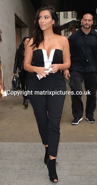 NON EXCLUSIVE PICTURE: PALACE LEE / MATRIXPICTURES.CO.UK<br /> PLEASE CREDIT ALL USES<br /> <br /> WORLD RIGHTS<br /> <br /> American media personality Kim Kardashian is pictured leaving the BBC Radio studios, in London.<br /> <br /> The 33 year old looks glamorous wearing a monochrome outfit. <br /> <br /> SEPTEMBER 3rd 2014<br /> <br /> REF: LTN 143896