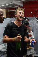 Rochester Red Wings pitcher Michael Tonkin celebrates in the locker room after defeating the Scranton Wilkes Barre RailRiders on September 2, 2013 at Frontier Field in Rochester, New York to clinch the International League Wild Card Playoff spot.  (Mike Janes/Four Seam Images)