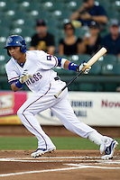 Round Rock Express outfielder Leonys Martin #27 attempts to bunt during the Pacific Coast League baseball game against the Las Vegas 51s on August 7th, 2012 at the Dell Diamond in Round Rock, Texas. The Express defeated the 51s 5-4. (Andrew Woolley/Four Seam Images)..