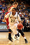 SIOUX FALLS, SD - MARCH 9:  Ceola Clark III #23 from Western Illinois gets a step around Casey Kasperbauer #14 from the University of South Dakota in the first half of their quarterfinal game Saturday evening at the 2013 Summit League Basketball Tournament in Sioux Falls, SD.  (Photo by Dave Eggen/Inertia)