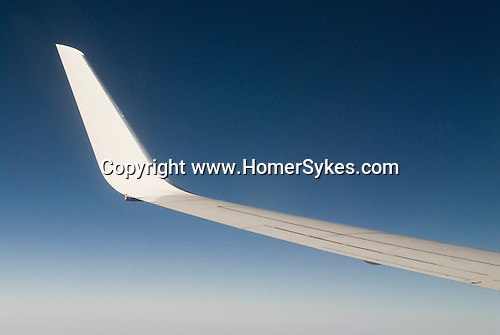 Wing of an airplane deep blue pal azore sky. Above the clouds  2006