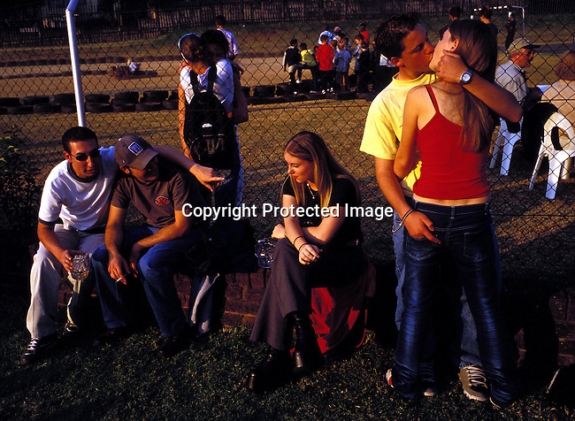 dipptee00030 .Teenager, JOHANNESBURG, SOUTH AFRICA - MAY 28: Unidentified youths socializing at a yearly youth festival on May 28, 2002 in Auckland Park a suburb in Johannesburg, South Africa. After eight years into democracy the white youth in the country has to compete with a growing black middleclass and elite about jobs and prosperity. Some whites that were rewarded in the old system have problems to adjust to competing and sharing the countryÕs wealth with the black population. .©Per-Anders Pettersson/iAfrika Photos