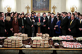 United States President Donald J. Trump speaks behind a table full of McDonald's hamburgers, Chick fil-a sandwiches and some other fast food as he welcomes the 2018 Division I FCS National Champions: The North Dakota State Bison in the State Dining Room of the White House on March 4, 2019 in Washington, DC. <br /> Credit: Oliver Contreras / Pool via CNP
