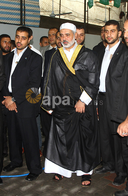Palestinian Prime Minister in Gaza Strip, Ismail Haniyeh watches a cow after slaughtering on the first day of Eid al-Adha in Gaza city on Nov.16,2010. Muslims around the world celebrate Eid al-Adha to mark the end of the haj by slaughtering sheep, goats, cows and camels to commemorate Prophet Abraham's willingness to sacrifice his son Ismail on God's command. Photo by Ashraf Amra
