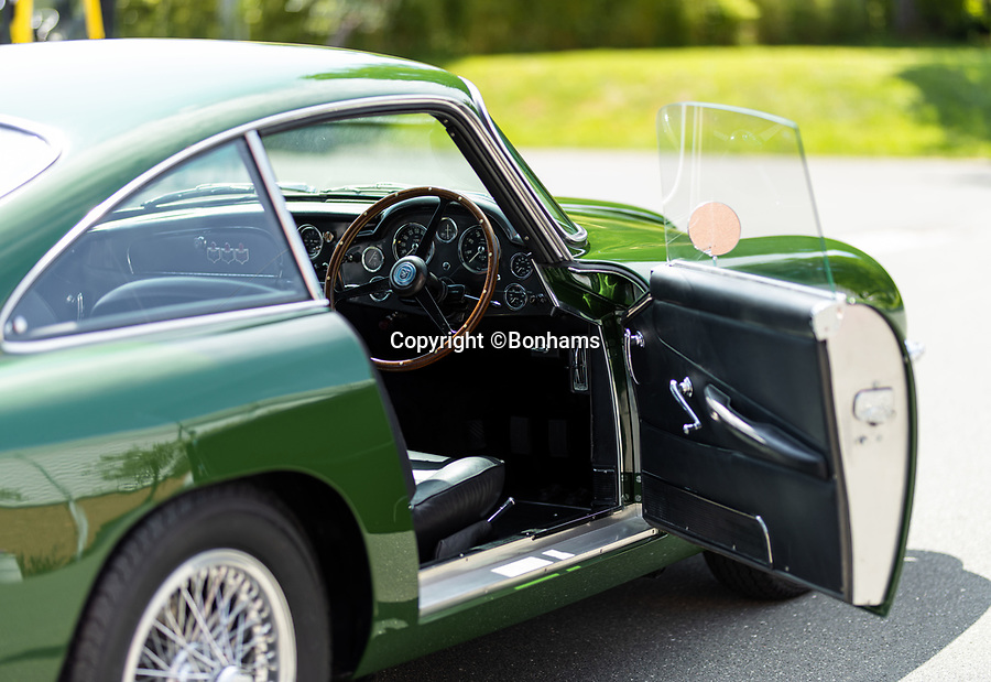 BNPS.co.uk (01202 558833)<br /> Pic: Bonhams/BNPS<br /> <br /> Speed King's beautiful old Aston Martin DB4 GT for sale...<br /> <br /> The rare Aston Martin car first owned by tragic speed record breaker Donald Campbell has emerged for sale for almost £3m.<br /> <br /> The 1961 Aston Martin DB4GT was one of just 75 to be built by the iconic British marque.<br /> <br /> It was previously owned by British adrenaline junkie Campbell, who is best known for his eight speed records on land and water before his death.<br /> <br /> He remains the the most prolific water speed record breaker of all-time and is still the only man ever to set both records in the same year in 1964.<br /> <br /> Campbell died during a final water speed record attempt on Coniston Water in the Lake District in 1967 and his body was not recovered until 2001.