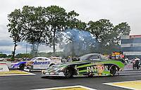Jun. 2, 2012; Englishtown, NJ, USA: NHRA funny car driver Alexis DeJoria (near) races alongside Matt Hagan during qualifying for the Supernationals at Raceway Park. Mandatory Credit: Mark J. Rebilas-