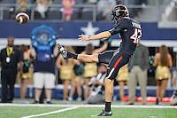 Texas Tech kicker Taylor Symmank (42) punts the ball away during an NCAA Football game, Saturday, November 29, 2014 in Arlington, Tex. Baylor defeated Texas Tech 48-46. (Mo Khursheed/TFV Media via AP Images)