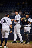 Staten Island Yankees David Adams (29) makes a pitching change as Andres Chaparro (30) and catcher Carlos Gallardo (65) look on during a NY-Penn League game against the Aberdeen Ironbirds on August 22, 2019 at Richmond County Bank Ballpark in Staten Island, New York.  Aberdeen defeated Staten Island 4-1 in a rain shortened game.  (Mike Janes/Four Seam Images)