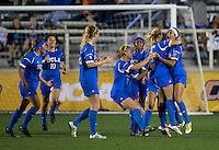 Ally Courtnall (42) of UCLA celebrates her goal with teammates during the Women's College Cup semifinals at WakeMed Soccer Park in Cary, NC. UCLA advance on penalty kicks after typing Virginia, 1-1 in regulation time.
