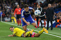 Eden Hazard of Chelsea attempts to evade the challenge of Yuval Shpungin of Maccabi Tel-Aviv during the UEFA Champions League match between Chelsea and Maccabi Tel Aviv at Stamford Bridge, London, England on 16 September 2015. Photo by David Horn.