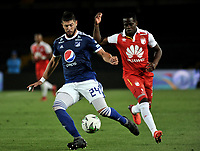 BOGOTÁ - COLOMBIA, 15-01-2019: Carmelo Valencia (Der.) jugador de Independiente Santa Fe disputa el balón con Matías de los Santos (Izq.) jugador de Millonarios, durante partido entre Independiente Santa Fe y Millonarios, por el Torneo Fox Sports 2019, jugado en el estadio Nemesio Camacho El Campin de la ciudad de Bogotá. / Carmelo Valencia (R) player of Independiente Santa Fe vies for the ball with con Matias de los Santos (L) player of Millonarios during a match between Independiente Santa Fe and Millonarios, for the Fox Sports Tournament 2019, played at the Nemesio Camacho El Campin stadium in the city of Bogota. Photo: VizzorImage / Luis Ramírez / Staff.