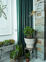 A stack of antique storage boxes fills a corner of the garden room