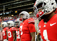 Ohio State Buckeyes quarterback Dwayne Haskins Jr. (7) leads the team on to the field for warm-ups prior to the Big Ten Championship against the Northwestern Wildcats at Lucas Oil Stadium in Indianapolis on Dec. 1, 2018. [Adam Cairns/Dispatch]
