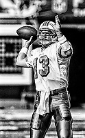 MIAMI, FL - DEC 19, 1999: (EDITOR'S NOTE: This image has been converted to black and white) Quarterback Dan Marino, #13, is shown on the field as his Miami Dolphins defeat the San Diego Chargers 12-9 at Joe Robbie Stadium, in Miami, FL. (Photo by Brian Cleary/www.bcpix.com)