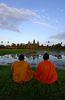Images from the Book Journey Through Colour and Time,Buddhist Monks during sunset at Angkor Wat