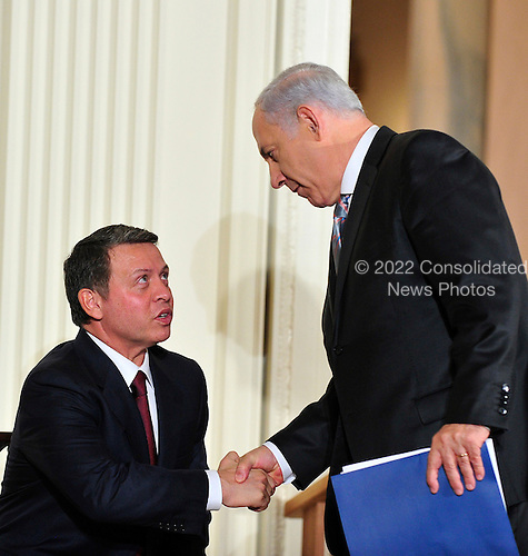 Prime Minister Benjamin Netanyahu of Israel shakes hands with King Abdullah II of Jordan after making remarks in the East Room of the White House following a series bi-lateral meetings in Washington, D.C. on Wednesday, September 1, 2010.  The statements are in advance of the opening of the first direct talks in two years between Israel and the Palestinian Authority scheduled to begin at the State Department in Washington, D.C. tomorrow.  .Credit: Ron Sachs / Pool via CNP.(RESTRICTION: NO New York or New Jersey Newspapers or newspapers within a 75 mile radius of New York City)