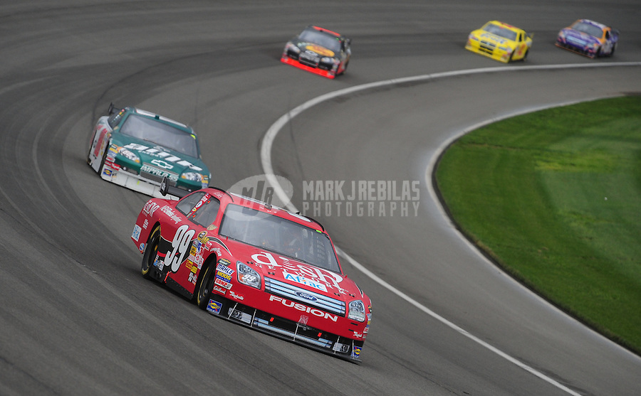 Feb 24, 2008; Fontana, CA, USA; NASCAR Sprint Cup Series driver Carl Edwards (99) leads Dale Earnhardt Jr (88) during the Auto Club 500 at Auto Club Speedway. Mandatory Credit: Mark J. Rebilas-US PRESSWIRE