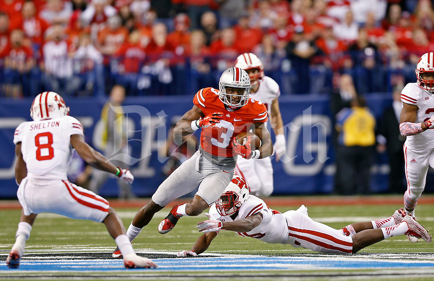 Ohio State Buckeyes wide receiver Michael Thomas (3) heads up field after a catch against Wisconsin Badgers during the 1st quarter in the 2014 Big Ten Football Championship Game at Lucas Oil Stadium in Indianapolis, Ind. on December 6, 2014.  (Dispatch photo by Kyle Robertson)