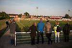 Spectators watching the first-half action at Yockings Park as Whitchurch Alport hosted Cammell Laird 1907 in the 2017-18 North West Counties Division One play-off final. Alport were formed in 1946 and were named after Alport Farm, Whitchurch, which had been the home of a local footballer Coley Maddocks who had been killed in action in the war. The home team won the match 2-1 watched by a crowd of 733, a club record attendance.