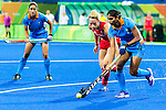 Renuka Yadav #24 of India carries the ball out of the circle while Helen Richardson-Walsh #8 of Great Britain covers during India vs Great Britain in a Pool B game at the Rio 2016 Olympics at the Olympic Hockey Centre in Rio de Janeiro, Brazil.