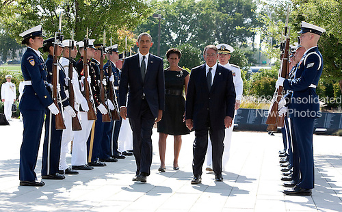 United States President Barack, First Lady Michelle Obama, U.S. Secretary of Defense Leon Panetta and Chairman of the Joint Chiefs of Staff Admiral Mike Mullen walk through an honor cordon before laying a wreath on the during a remembrance ceremony at the Pentagon in Washington, DC, on Sunday, September 11, 2011..Credit: Joshua Roberts / Pool via CNP
