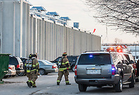 STAFF PHOTO ANTHONY REYES &bull; @NWATONYR<br /> Rogers firefighters return to their engine at the scene of an ammonia leak Wednesday, Dec. 10, 2014 at the Tyson Foods plant on Olrich Street in Rogers. Several people were injured in the leak with a variety of minor to serious injuries.