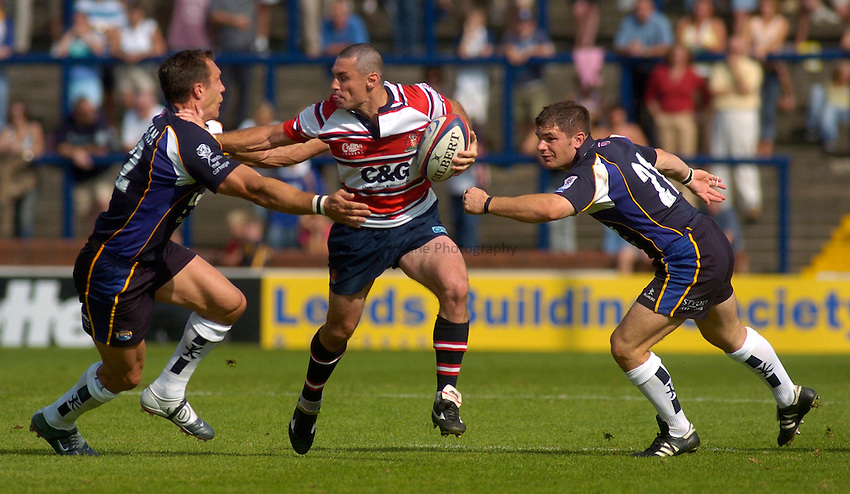 Photo. Glyn Thomas. .Leeds Tykes v Gloucester. .Zurich Premiership. 05/09/2004..Gloucester's Duncan McRae (C) finds a path through past Leeds' Gordon Ross (R) and Andre Snyman.
