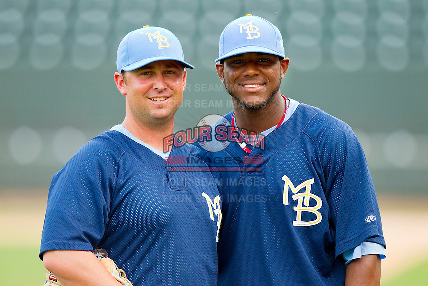Myrtle Beach Pelicans coach Kenny Holmberg #22 and Hanser Alberto #12 pose for a photo prior to the game against the Winston-Salem Dash at BB&T Ballpark on July 5, 2012 in Winston-Salem, North Carolina.  The Dash defeated the Pelicans 12-5.  (Brian Westerholt/Four Seam Images)