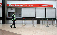 RIONEGRO, COLOMBIA - MAY 12: A security guard is in the check-in area of the Avianca airline office at the José María Córdoba International Airport on May 12, 2020 in Rionegro. Avianca filed for bankruptcy in the United States on May 11, 2020 to reorganize its debt due to the impact of the coronavirus pandemic. (Photo by Fredy Builes / VIEWpress via Getty Images)
