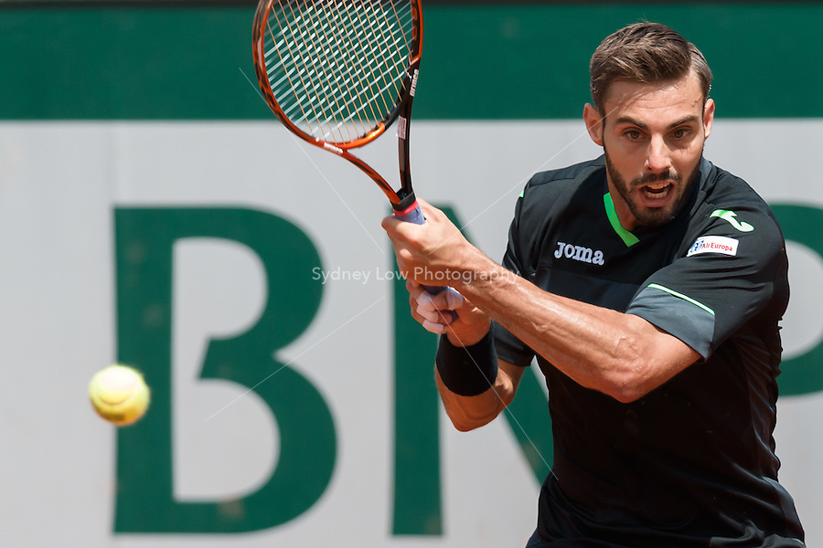 May 27, 2015: Marcel Granollers of Spain in action in a 2nd round match against Roger Federer of Switzerland on day four of the 2015 French Open tennis tournament at Roland Garros in Paris, France. Sydney Low/AsteriskImages