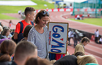 Spectators arrive carrying banner for Mo Farah who run his final track event in the UK during the Muller Grand Prix Birmingham Athletics at Alexandra Stadium, Birmingham, England on 20 August 2017. Photo by Andy Rowland.