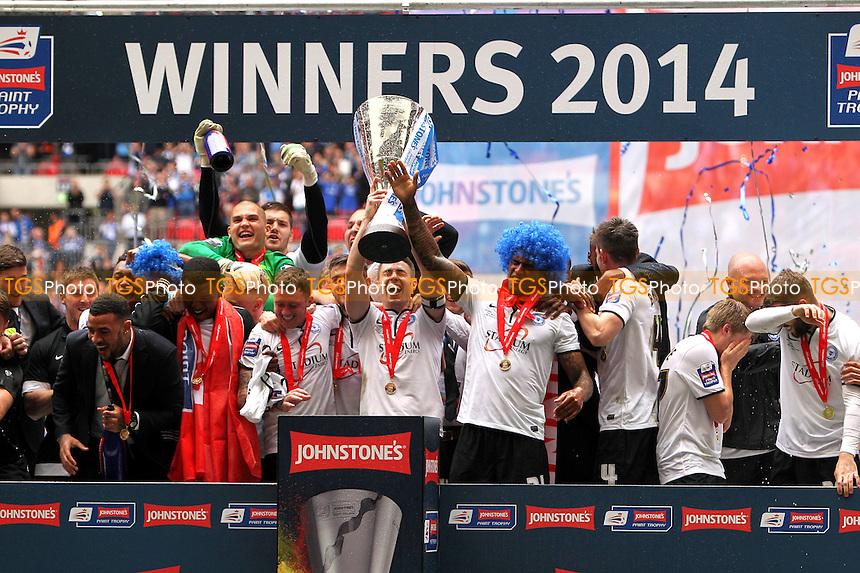 Peterborough United celebrate winning the Johnstones Paint Trophy - Johnstones Paint Trophy Final at Wembley Stadium, London - 30/03/14 - MANDATORY CREDIT: Simon Roe/TGSPHOTO - Self billing applies where appropriate - 0845 094 6026 - contact@tgsphoto.co.uk - NO UNPAID USE