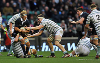Twickenham, GREAT BRITAIN, Oxford's Gus JONES hangs onto the ball as left Max MATHER and Nate BRAKLEY attempt get the ball during the  2012 Varsity Rugby match.  Oxford vs Cambridge, at the RFU Stadium, Twickenham, Surrey. on Thursday  06/12/2012...[Mandatory Credit; Peter Spurrier/Intersport-images]