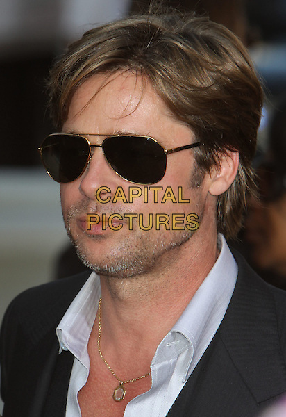 "BRAD PITT  .""Salt"" Los Angeles Premiere held at Grauman's Chinese Theatre, Hollywood, California, USA..July 19th, 2010.headshot portrait black blue aviators stubble facial hair necklace sunglasses shades .CAP/ADM/CH.©Charles Harris/AdMedia/Capital Pictures"
