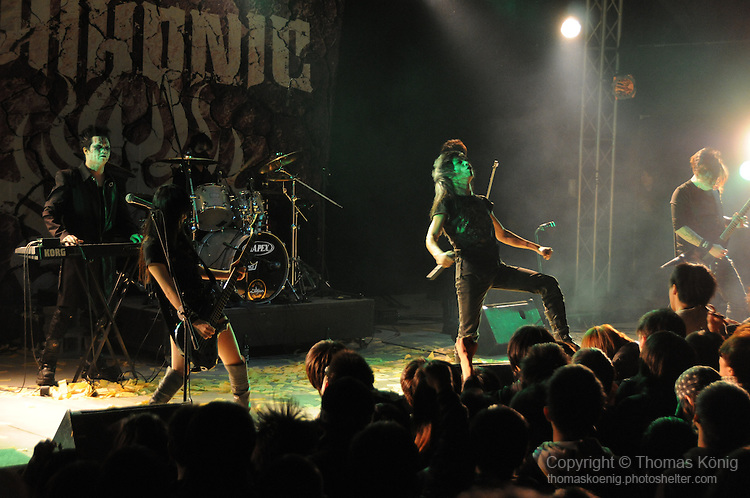 Chthonic Concert, Kaohsiung -- The Taiwanese Black Metal band Chthonic on stage in front of fans.