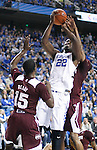 Forward Alex Poythress of the Kentucky Wildcats shoots the ball under pressure during the game against the Mississippi State Bulldogs at Rupp Arena on January 20, 2015 in Lexington, Kentucky. Photo by Taylor Pence