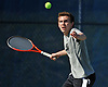 Brian Hoffarth of St. Anthony's High School returns a volley during the NSCHSAA varsity boys' tennis singles championship match against Chaminade junior Colin Sacco at Hofstra University on Thursday, May 7, 2015. The Loyola University-bound senior bested Sacco 6-3, 6-2 to win the league's singles title.<br /> <br /> James Escher