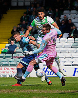 Omar Sowunmi of Yeovil Town middle heads past Wycombe Wanderers keeper Scott Brown of Wycombe Wanderers under pressure from  Adam El-Abd of Wycombe Wanderersduring Yeovil Town vs Wycombe Wanderers, Sky Bet EFL League 2 Football at Huish Park on 14th April 2018