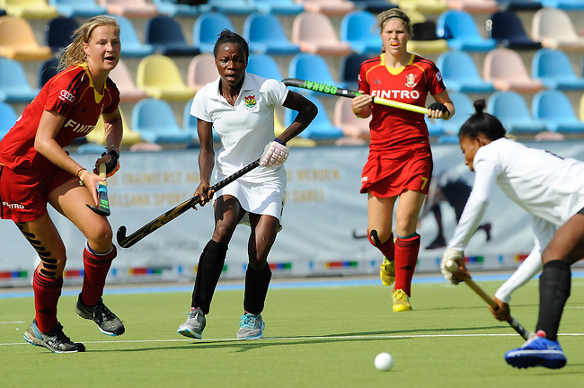 MOENCHENGLADBACH, GERMANY - AUGUST 03: 13-16th classification game between Ghana (white) and Belgium (red) during the Hockey Junior World Cup at the Warsteiner HockeyPark on August 03, 2013 in Moenchengladbach, Germany. Final score after shoot out 4-5. (Photo by Dirk Markgraf/www.265-images.com) *** Local caption ***