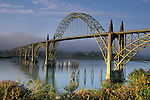 Sunrise light on the Yaquina Bay Bridge and fog over Yaquina Bay, Newport, Oregon Coast