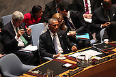 United States Ambassador to the U.N. Samantha Power whispers into the ear of U.S. President Barack Obama as he chairs the U.N. Security Council summit cracking down on foreign terrorist fighters at the U.N. 69th General Assembly in New York, New York on Wednesday, September 24, 2014.  Also visible in the photo is U.S. Secretary of State John F. Kerry.<br /> Credit: Allan Tannenbaum / Pool via CNP