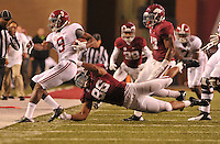 NWA Media/Michael Woods --10/11/2014-- w @NWAMICHAELW...Alabama receiver Amari Coper is knocked out of bounds by Arkansas defender Trey Flowers  in the 4th quarter of Saturdays game at Razorback Stadium in Fayetteville.