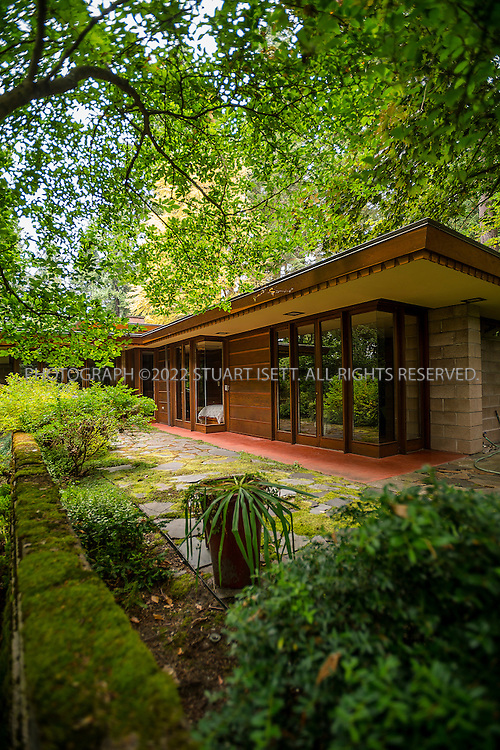 """10/9/2012--Sammamish, WA, USA..VIEW: Exterior showing rear of house with bedrooms on small, paved veranda...Architect Frank Lloyd Wright planned his """"Usonian"""" homes to be affordable for middle-class families. The 1,9500 square foot Brandes home is for sale in Sammamish, Washington (30 minutes from Seattle) at $1.39 million. It features three bedrooms, two bathrooms and a small, separate office/study space...The home was built in 1952, and has redwood trim and Wright's original furniture and some garden sculptures by Wright. It's one of only three Frank Lloyd Wright homes near Seattle...©2012 Stuart Isett. All rights reserved."""