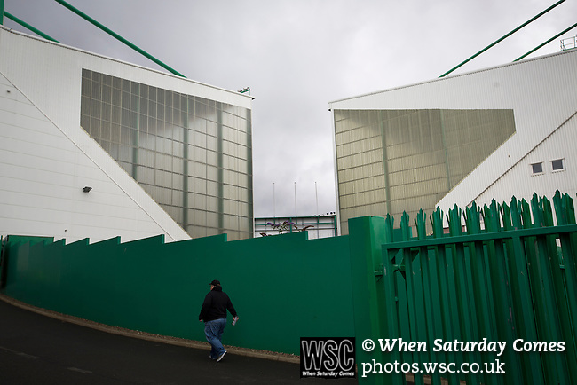 Hibernian 3 Alloa Athletic 0, 12/09/2015. Easter Road stadium, Scottish Championship. A fan making his way towards the East Stand at Easter Road stadium before the Scottish Championship match between Hibernian and visitors Alloa Athletic. The home team won the game by 3-0, watched by a crowd of 7,774. It was the Edinburgh club's second season in the second tier of Scottish football following their relegation from the Premiership in 2013-14. Photo by Colin McPherson.