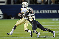 17 September 2011:  FIU defensive back Jose Cheeseborough (27) tackles UCF quarterback Jeff Godfrey (2) in the second half as the FIU Golden Panthers defeated the University of Central Florida Golden Knights, 17-10, at FIU Stadium in Miami, Florida.