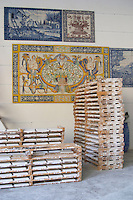 A workshop manufacturing hand made painted enamelled tiles in traditional Portuguese style, azulejos. Azeitao, Portugal.