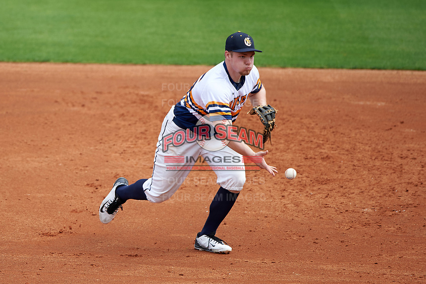 Canisius College Golden Griffins first baseman Ryan Stekl (15) flips the ball to first after fielding a ground ball during the first game of a doubleheader against the Michigan Wolverines on February 20, 2016 at Tradition Field in St. Lucie, Florida.  Michigan defeated Canisius 6-2.  (Mike Janes/Four Seam Images)