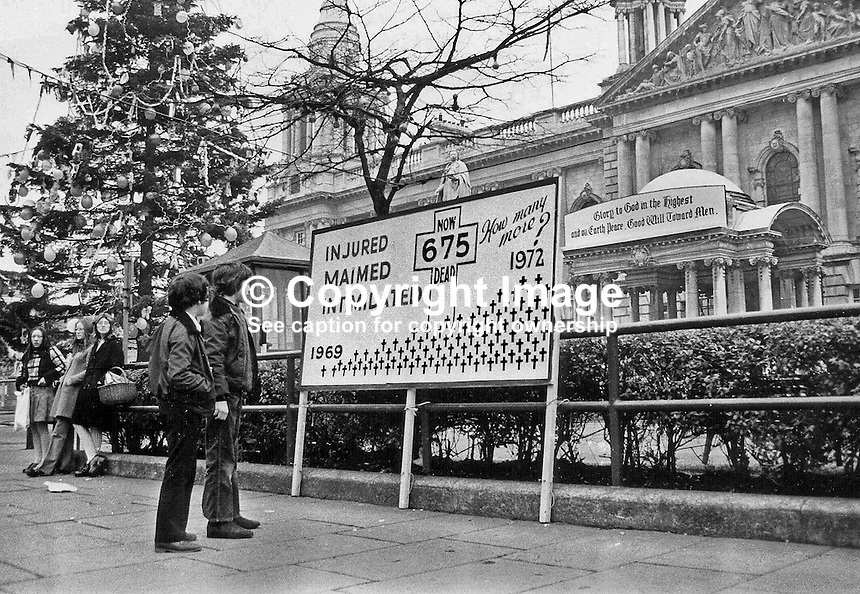 Special Christmas Hoarding at Belfast City Hall spells out the number (675) of dead to date in the N Ireland Troubles. Christmas Tree. 197212020.<br /> <br /> Copyright Image from Victor Patterson, 54 Dorchester Park, Belfast, UK, BT9 6RJ<br /> <br /> t: +44 28 90661296<br /> m: +44 7802 353836<br /> vm: +44 20 88167153<br /> e1: victorpatterson@me.com<br /> e2: victorpatterson@gmail.com<br /> <br /> For my Terms and Conditions of Use go to www.victorpatterson.com